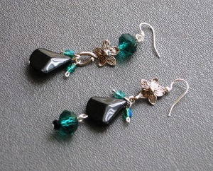 From the Soup: one of the clasps I was sent and the tiny, green Czech glass beads.