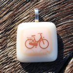 http://www.etsy.com/listing/40393495/bicycle-pendant-fused-glass-pendant-bike