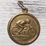 http://www.etsy.com/listing/150363434/vintage-bicycle-medal-light-brass-charm