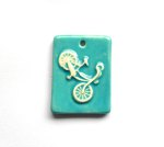 http://www.etsy.com/listing/129074105/handmade-ceramic-bicycle-pendant-in